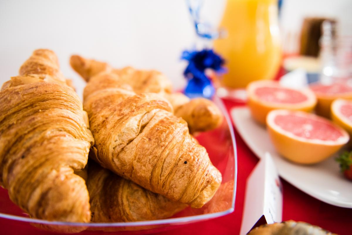 big breakfast croissants fruit table