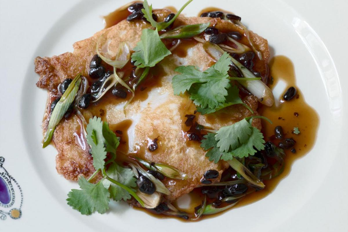 Crispy fried goose egg with black beans