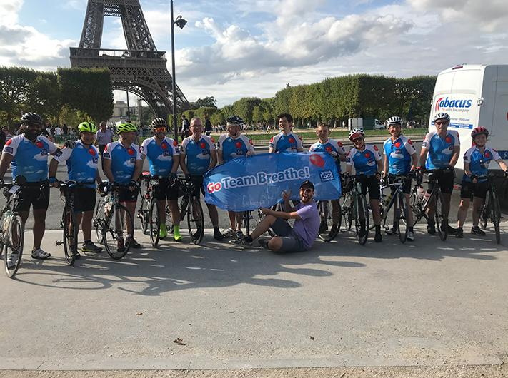 The Ride London to Paris cycle team celebrate in Paris in front of the Eiffel Tower after completing their three day journey.