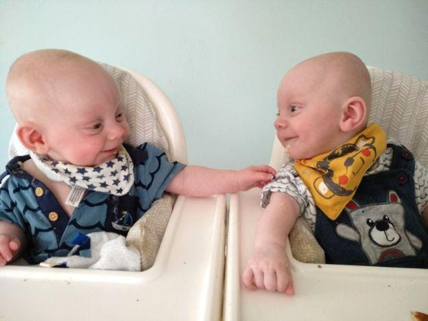Reece and Luca in their high chairs