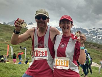Jason and Julie with their medals for completing the Zermatt ultra marathon
