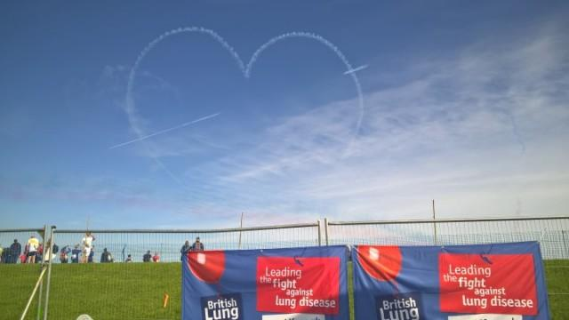 Red Arrows heart Team Breathe logo sky