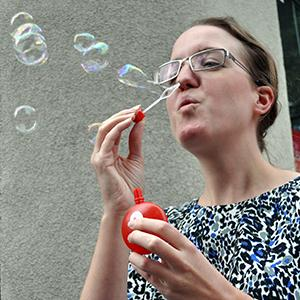 Ruth blows bubbles for IPF awareness