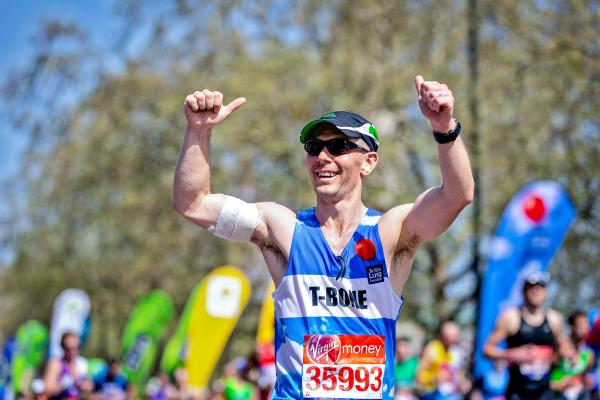 London Marathon man running with thumbs up