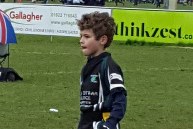 James playing rugby