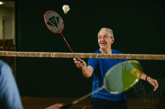 John playing badminton