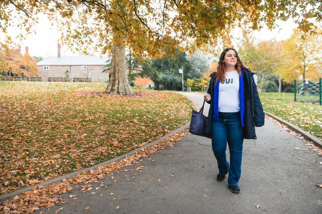Young woman with asthma walking in the park