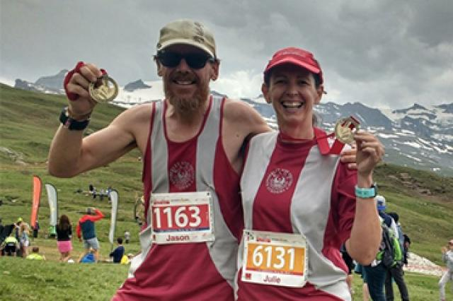 Matt and Julie with their medals for completing the Zermatt ultra marathon