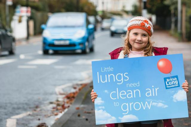 Clean air banner and little girl