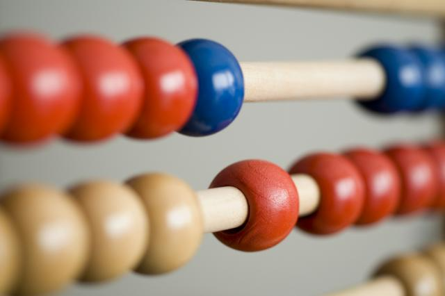 An abacus containing red, blue and yellow beads.