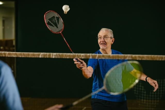 Man with a lung condition playing badminton