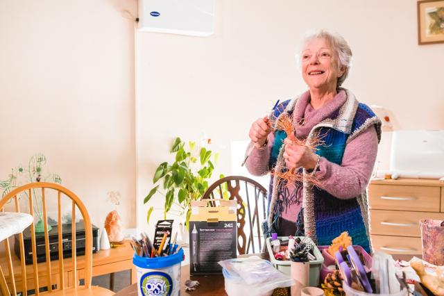 woman with lung condition doing arts and crafts